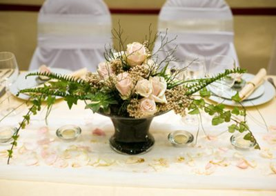 Elegant place setting with roses